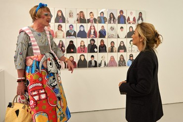UAL Chancellor, Grayson Perry, chats with graduate Shadi Mahsa at the UAL Postgraduate Summer Show, Chelsea College of Arts, London. Image courtesy UAL and Channel 4 News.