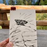 Portrait-oriented postcard featuring a butterfly perched on a finger.