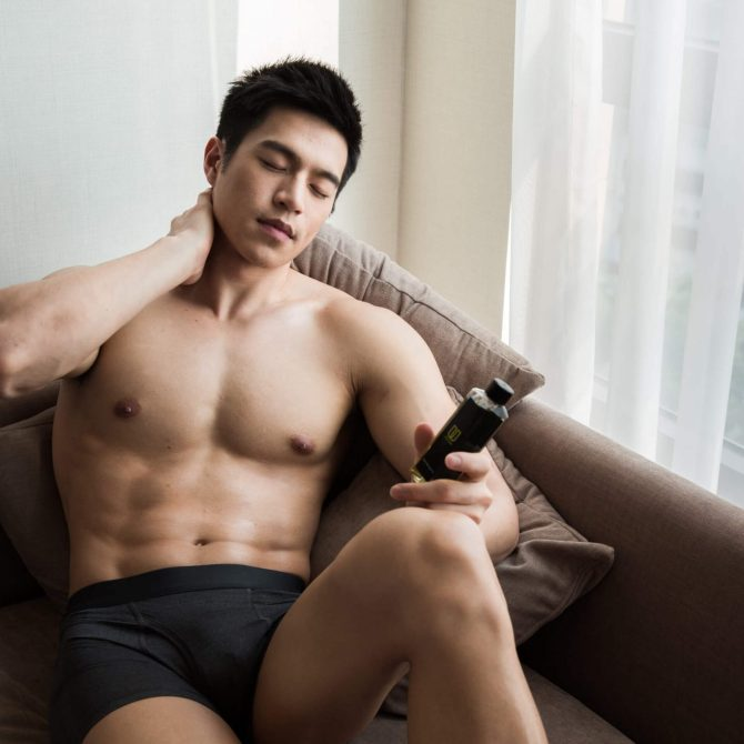 man-using-massage-oil