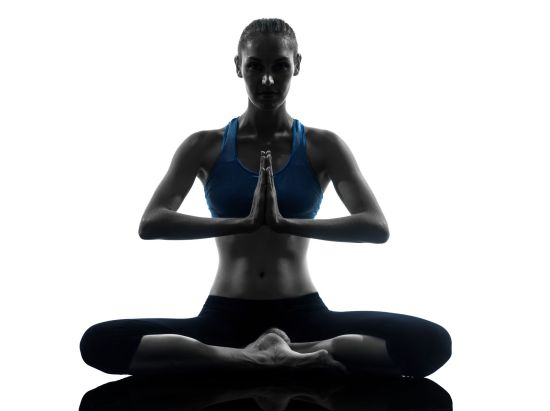 25511477 - one caucasian woman exercising yoga meditating sitting hands joined in silhouette studio isolated on white background