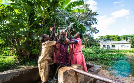 Community outreach, children playing with water