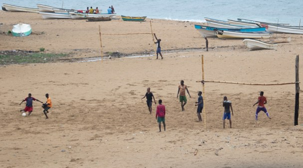 Locals playing soccer on a beach in Moheli