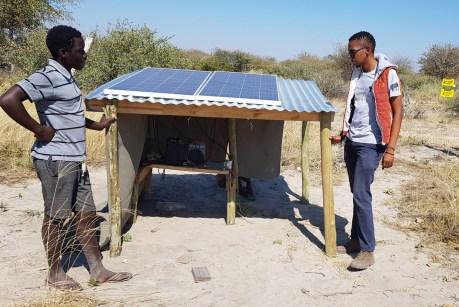Walona Sehularo of Elephants for Africa and Clifford show me the solar electric fence system © Simon Espley