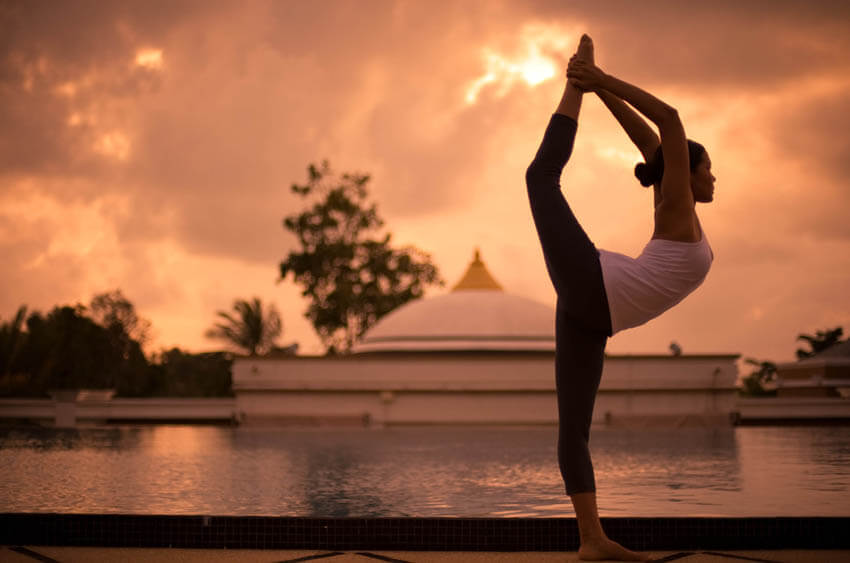 Yoga at sunset   Image courtesy of Absolute Sanctuary