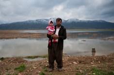 Iran. Marivan. Father and little daughter on Zrebar Lake. March 2016