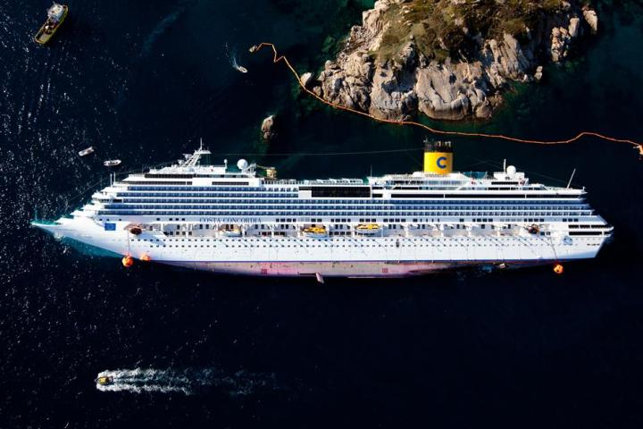"Giglio Island (GR), zenithal view of the cruised ship ""Costa Concordia"" from an helicopter of Police after the disaster © Massimo Sestini"