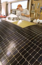 Jason Nolte works on the 334-pound Solar Miner IV. Photos courtesy of the Springfield (Mo.) News-Leader.