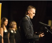 Cody Seckfort, a senior in geological engineering and an Army ROTC cadet, recognizes honoree Joe Ballard, MS EMgt'72.