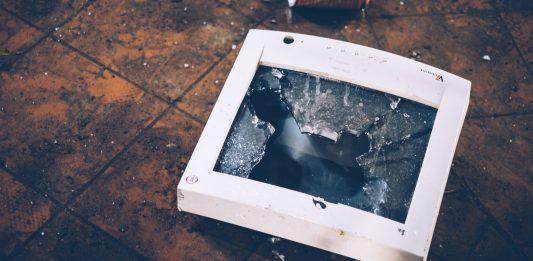 A broken monitor on the floor