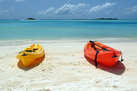 Kayaks on a beach in the Maldives