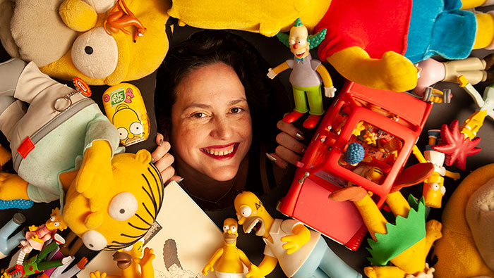 UC Davis Professor Karma Waltonen poses with Simpsons memorabilia