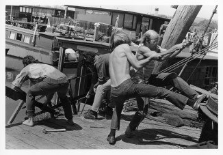 Four men working on a dock.