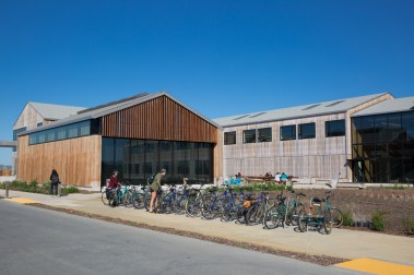 Students park bicycles outside the new Coastal Biology building, completed this fall. The state-of-the-art 40,000-square foot facility supports research and teaching on coastal conservation, ecology, habitat restoration, climate change impacts, and policy. The building includes a 125-seat classroom and two smaller classrooms; running seawater plumbed to a core seawater laboratory for teaching classes and holding live marine life; analytical labs and rooms for specialized equipment; meeting spaces and conference rooms; and offices and research laboratories.