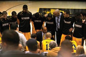 Basketball team huddles up