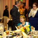 People mingle at scholar luncheon