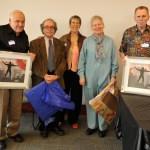 ancient studies reunion people holding photographs