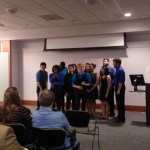 Group sings at political science reception