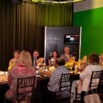Display behind society dinner group