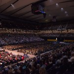 zoomed out photo of crowd at 2014 undergraduate commencement