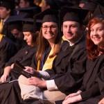 Graduates smile together