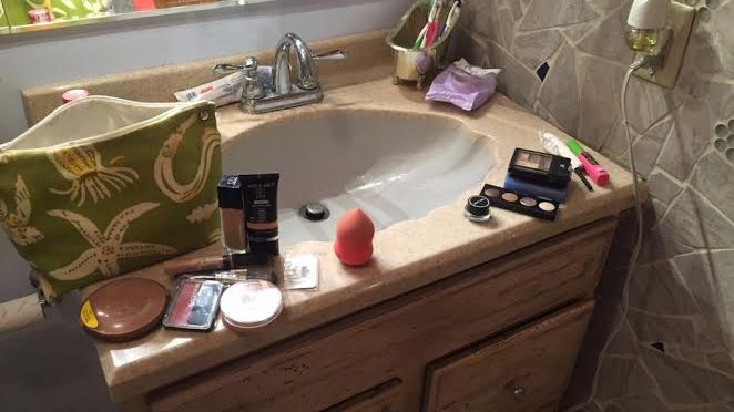 sink with skin care and makeup products