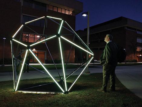Man admires light up diamond art