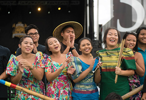 Student and alumni performers make a joyful noise all day long on the House of Grit Community Festival stage.