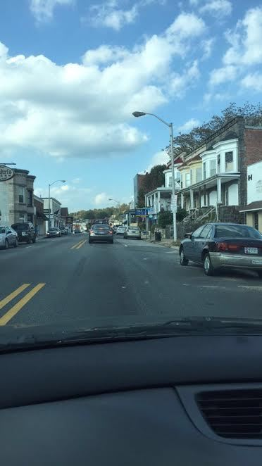 picture through car windshield of street