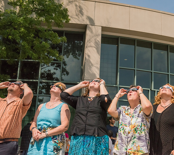 group wearing eclipse glasses to view eclipse