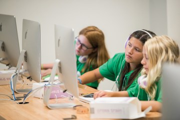 3 young girls practicing their coding skills