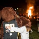 UMBC Mascot embraces student at Bonfire