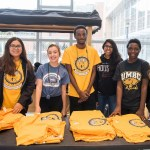 UMBC Students pose at t-shirt station