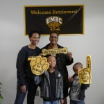 family poses with UMBC cheer gear