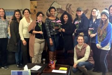 Women center staff pose with women graduates