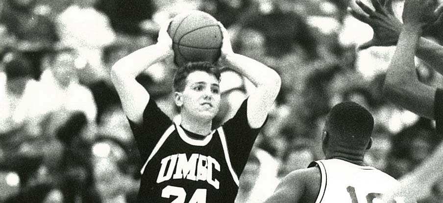 close up black and white picture of UMBC basketball player passing the ball