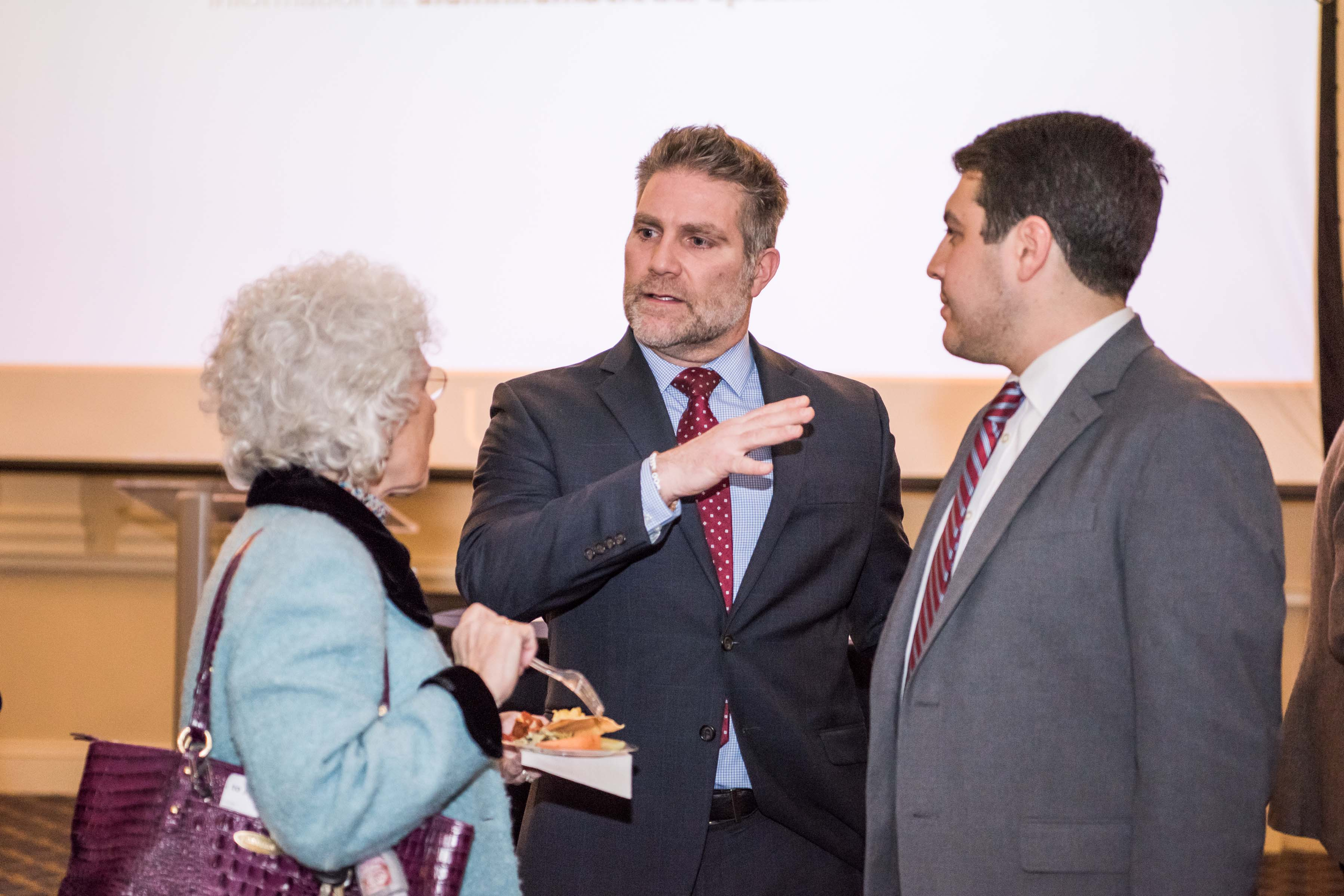 Three people in conversation at Annapolis Alumni Reception