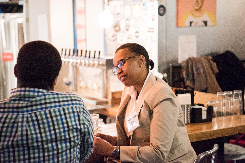 People interact at bar during chocolate city bar talk