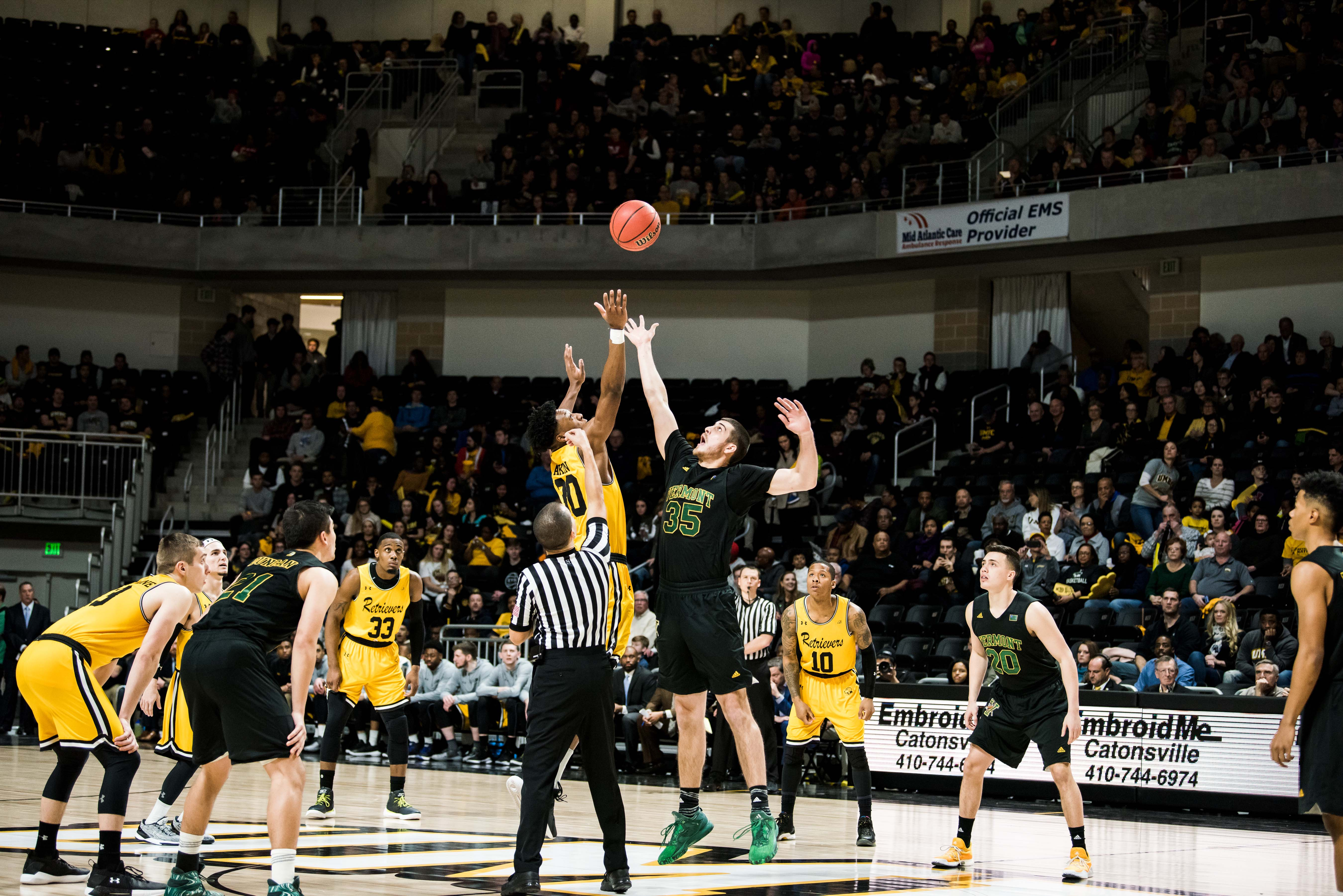 Mens basketball game for event center opening