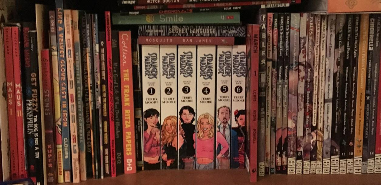shelf full of comics