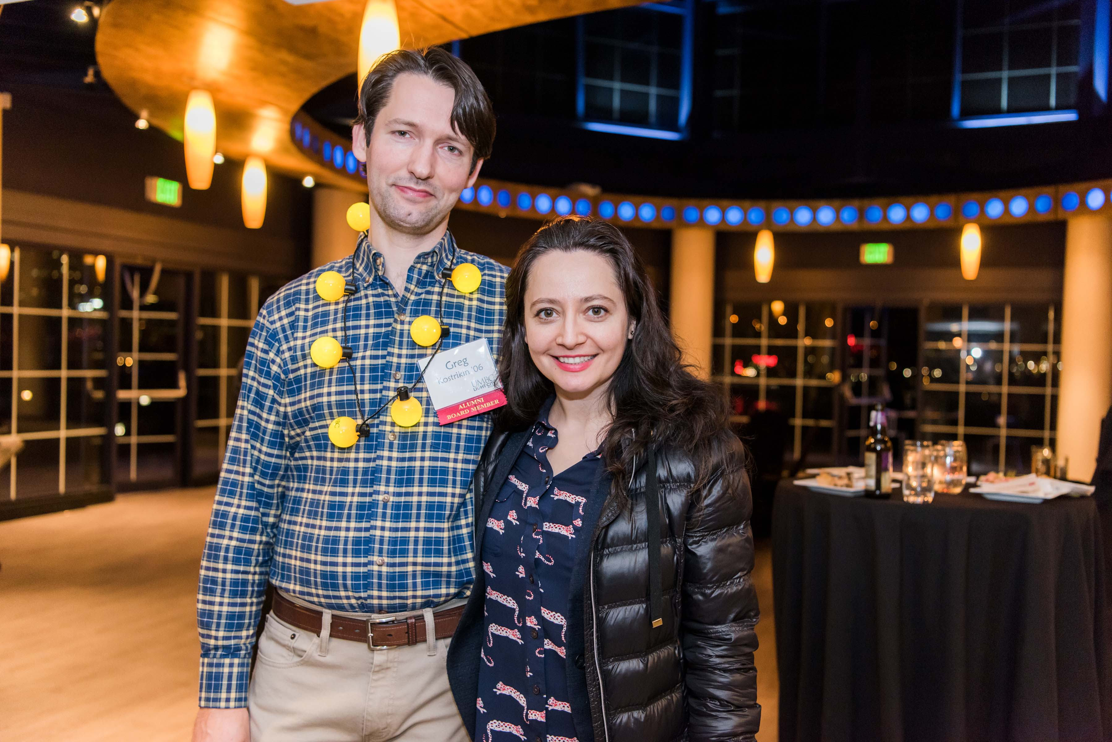 Two people pose together for picture at pier reception