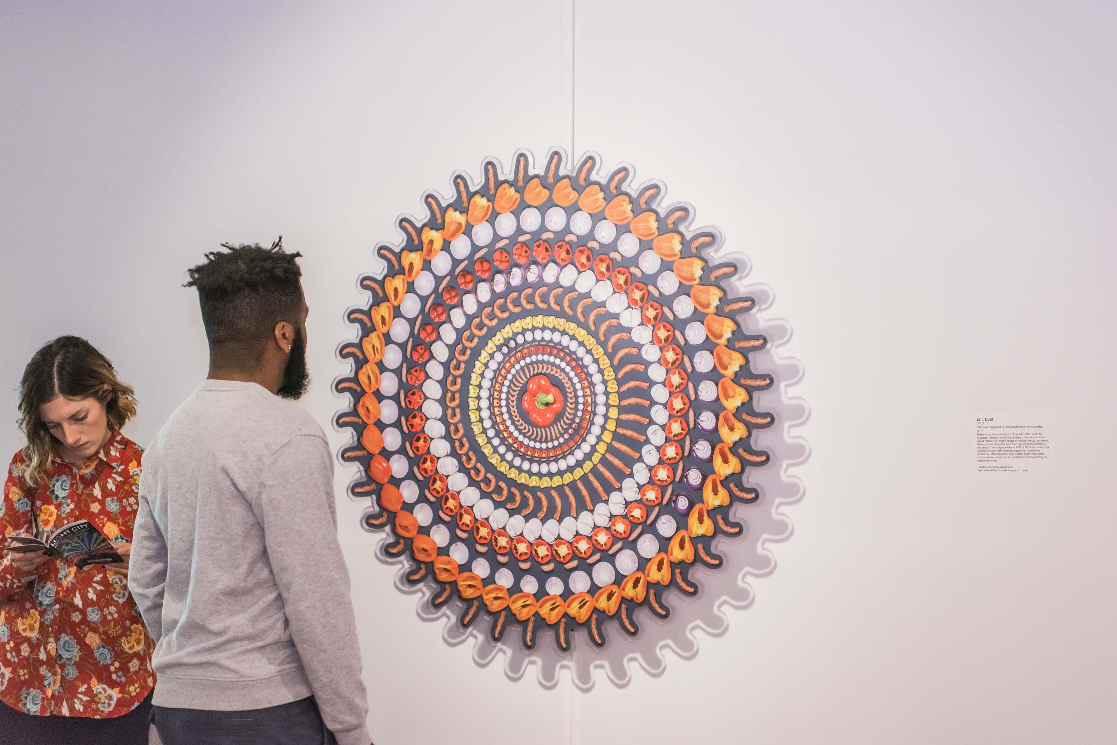 Man looks at art work depicting food