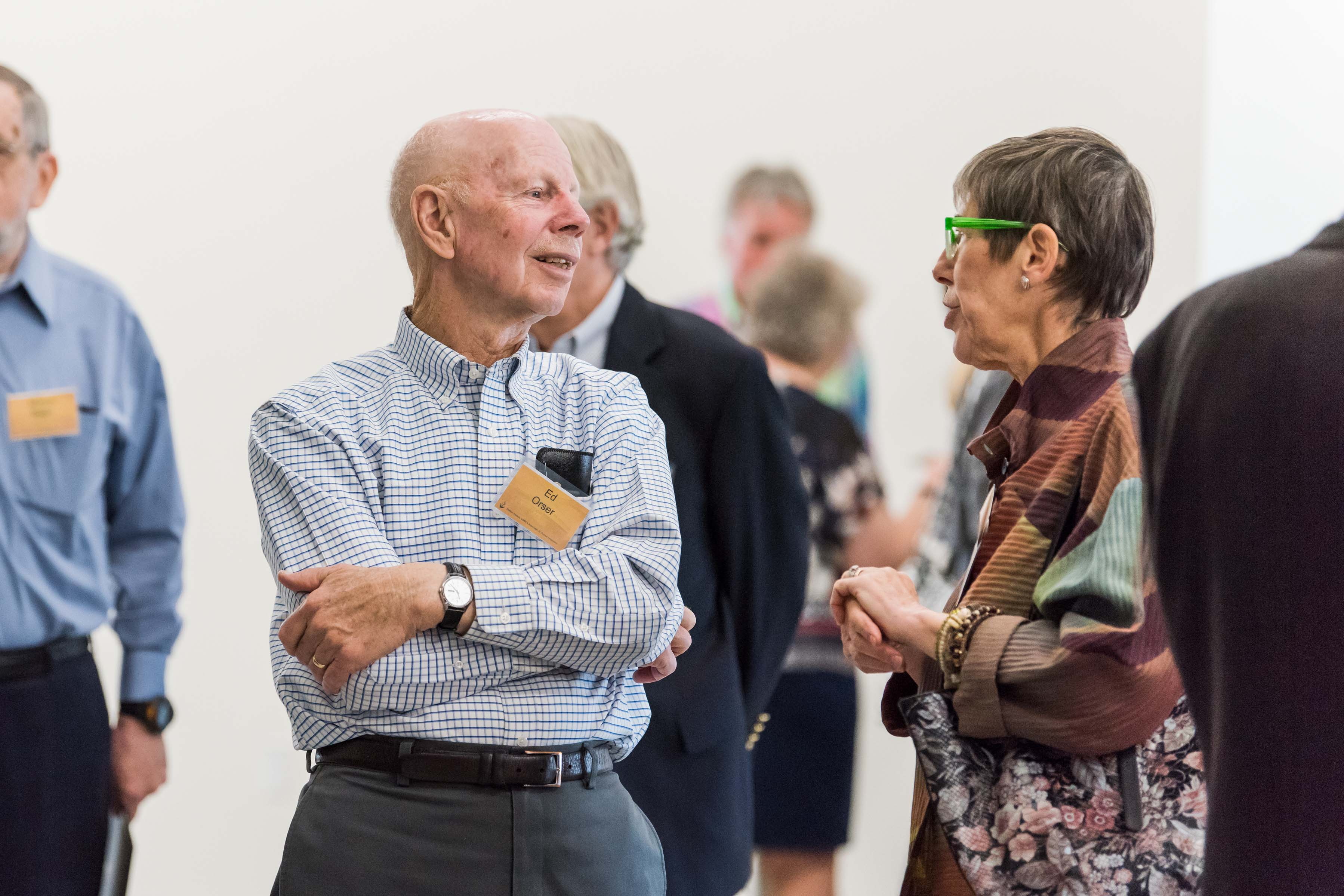 Two people in conversation at Wisdom Institute lunch
