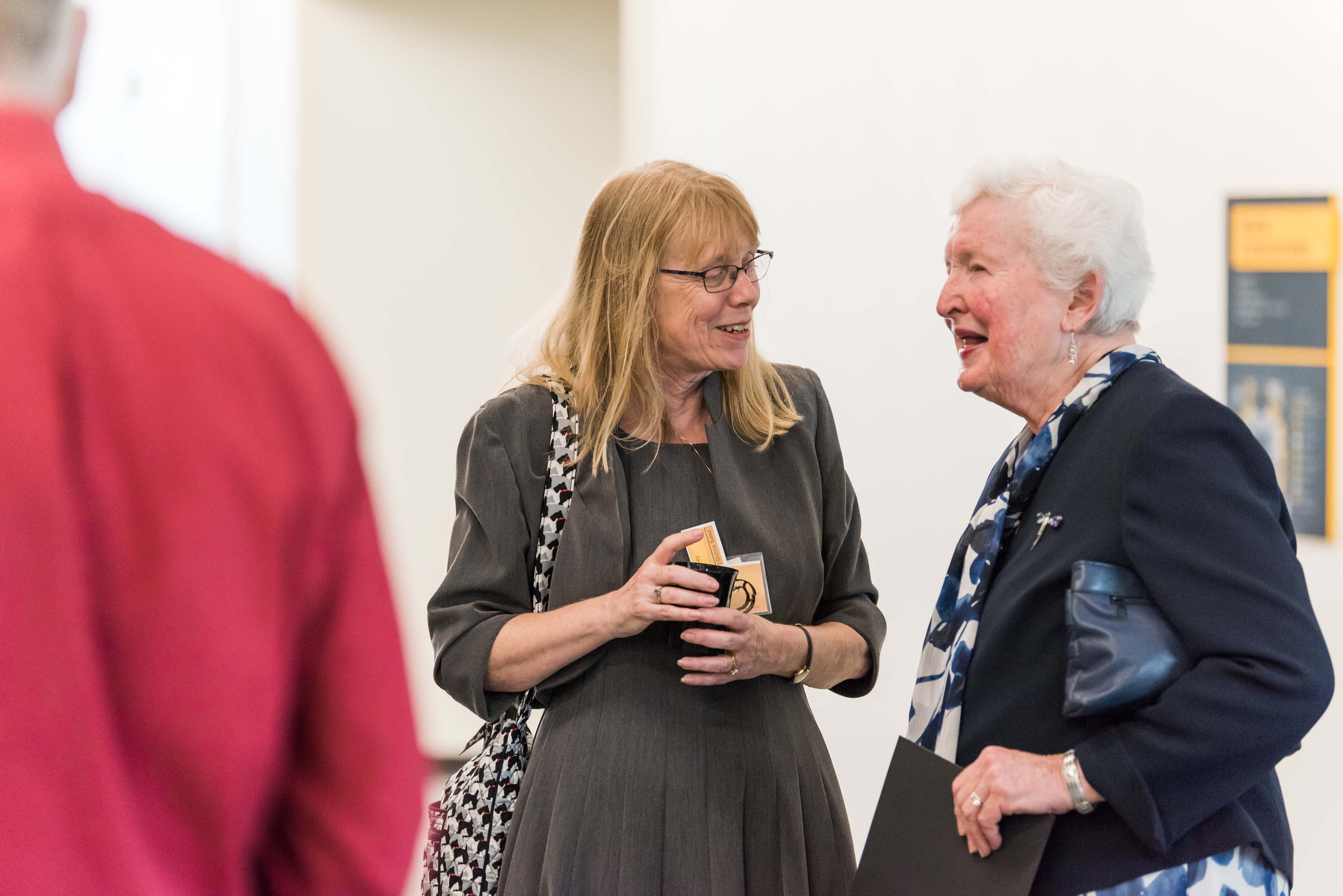 Two women talking at Wisdom Institute lunch