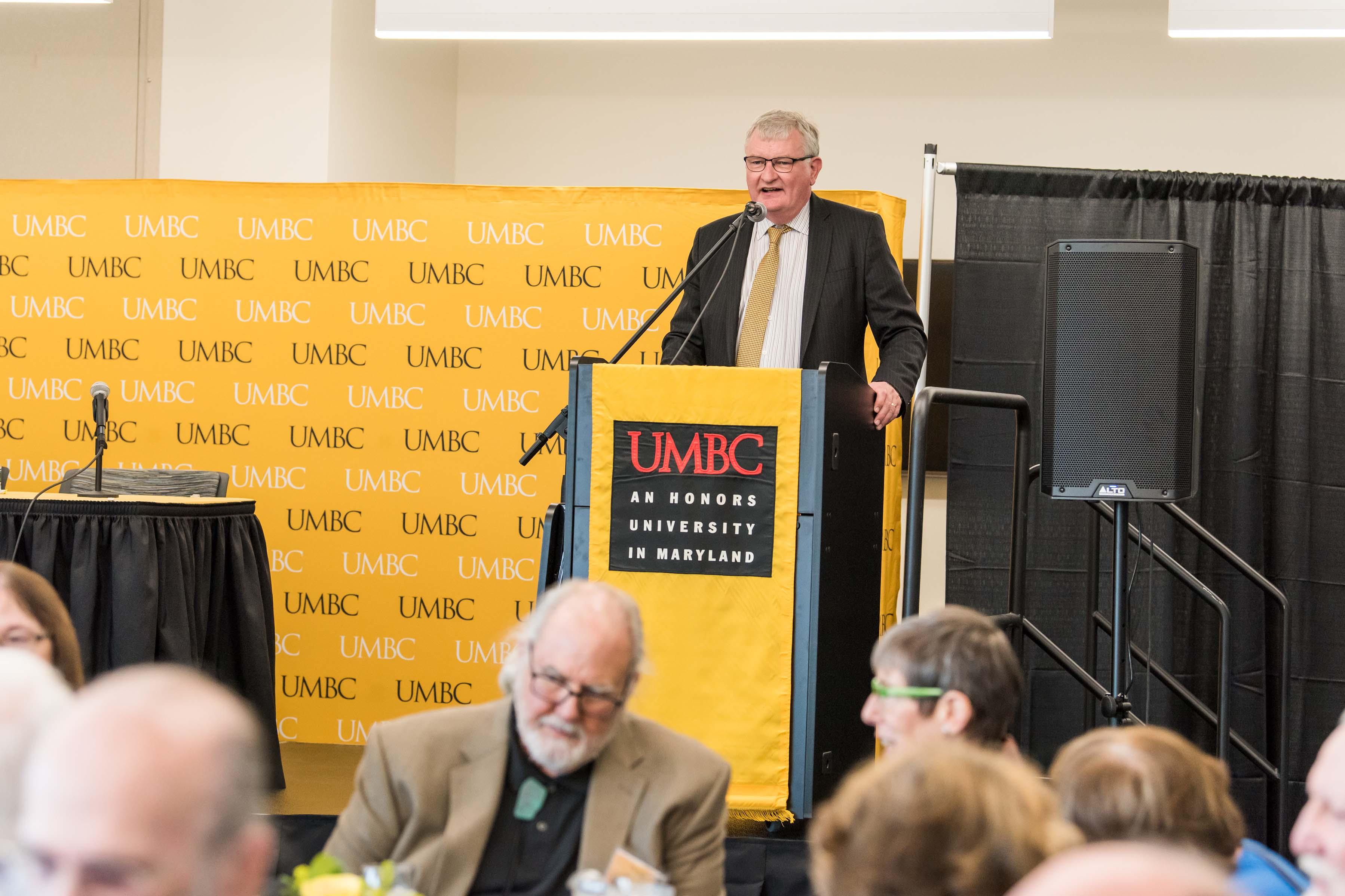Provost Rous speaks behind UMBC podium