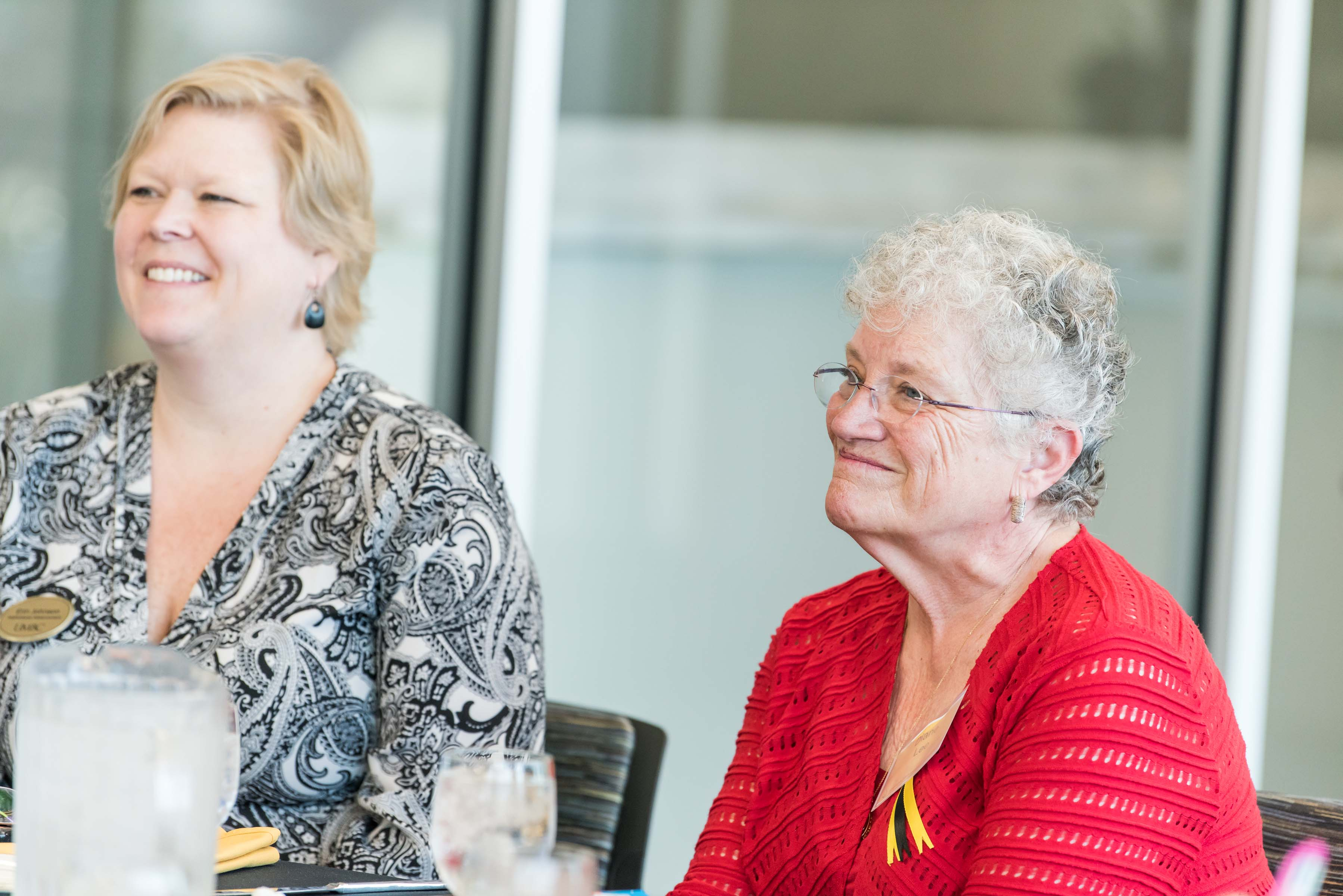 Women smiling at Wisdom Institute lunch