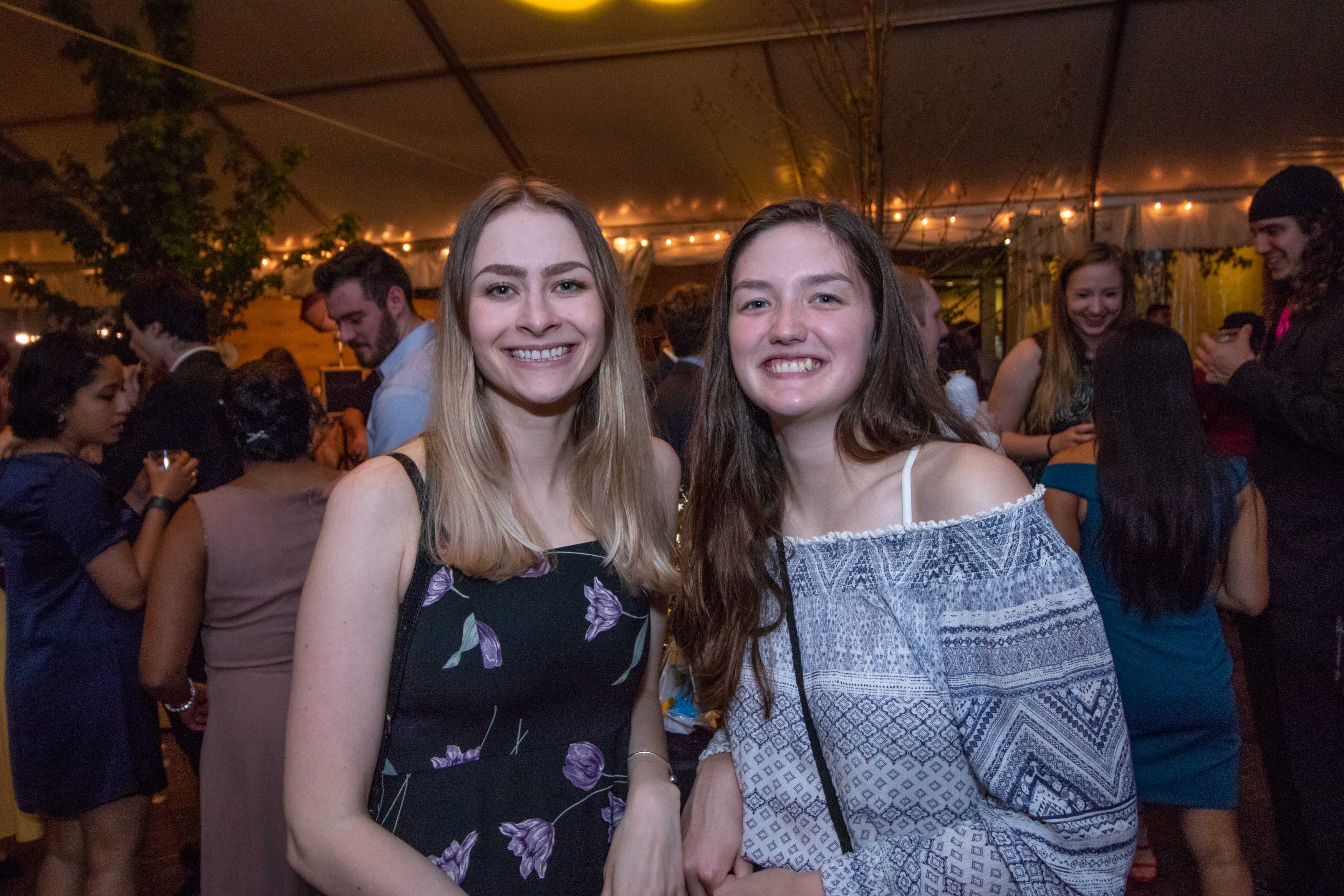 Two girls pose together at Grad dance