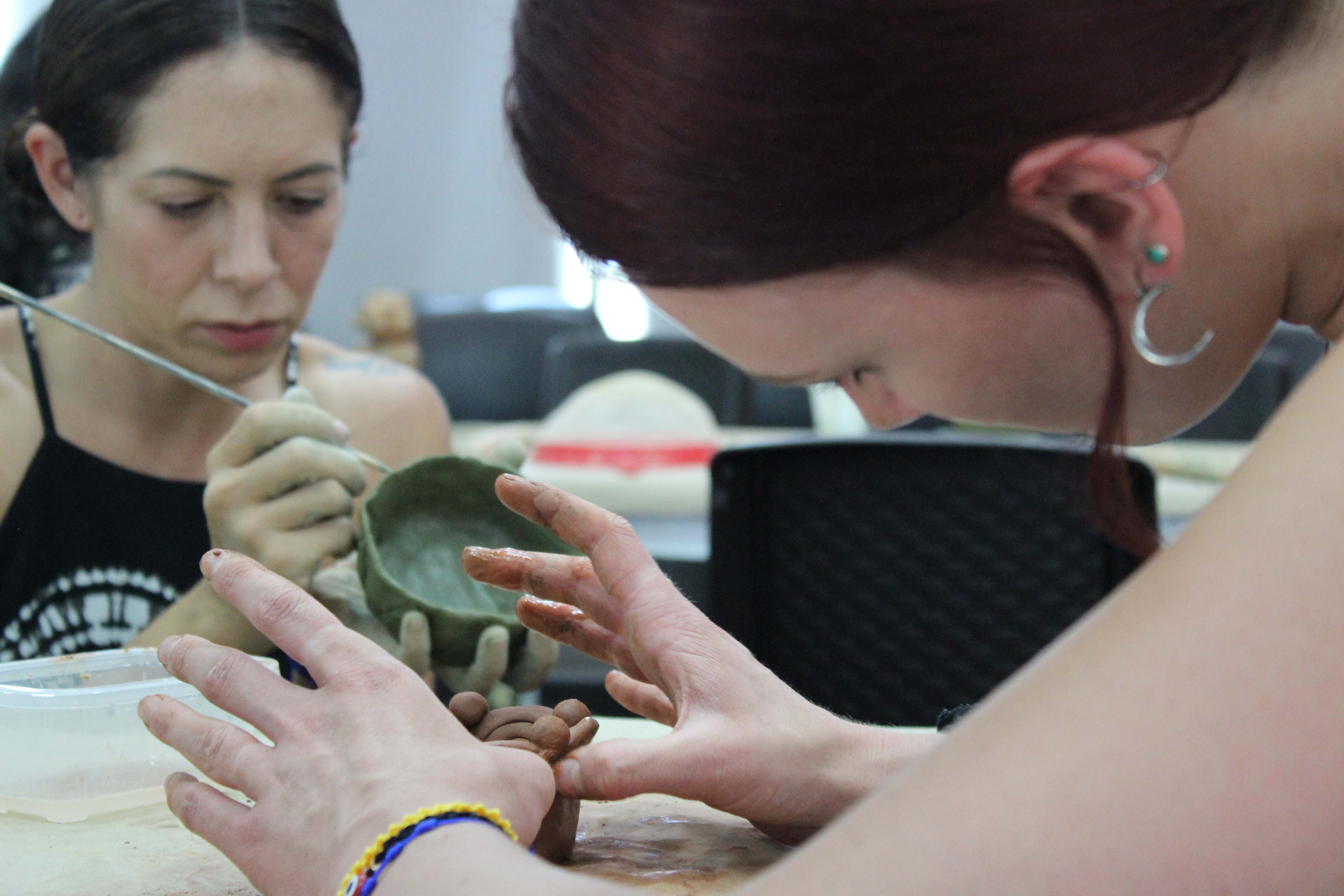 Students making pottery abroad