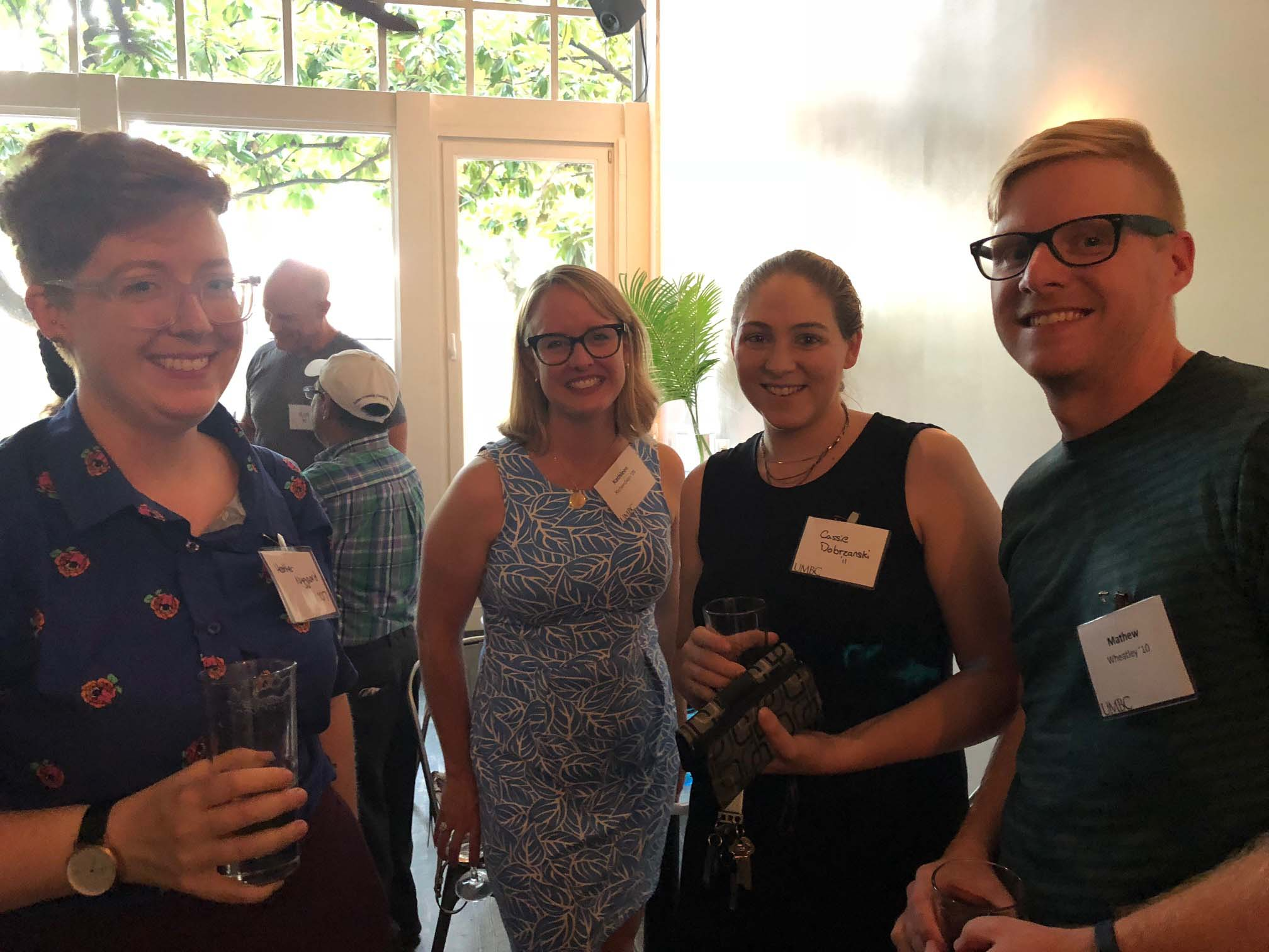 Group of four pose together for Seattle alumni gathering