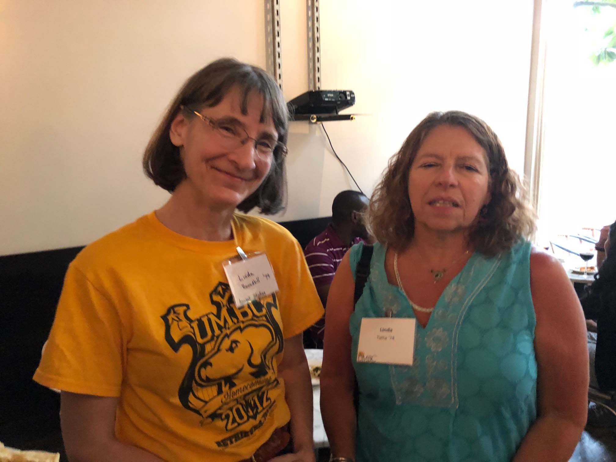 Two Alumnae pose together for Seattle gathering