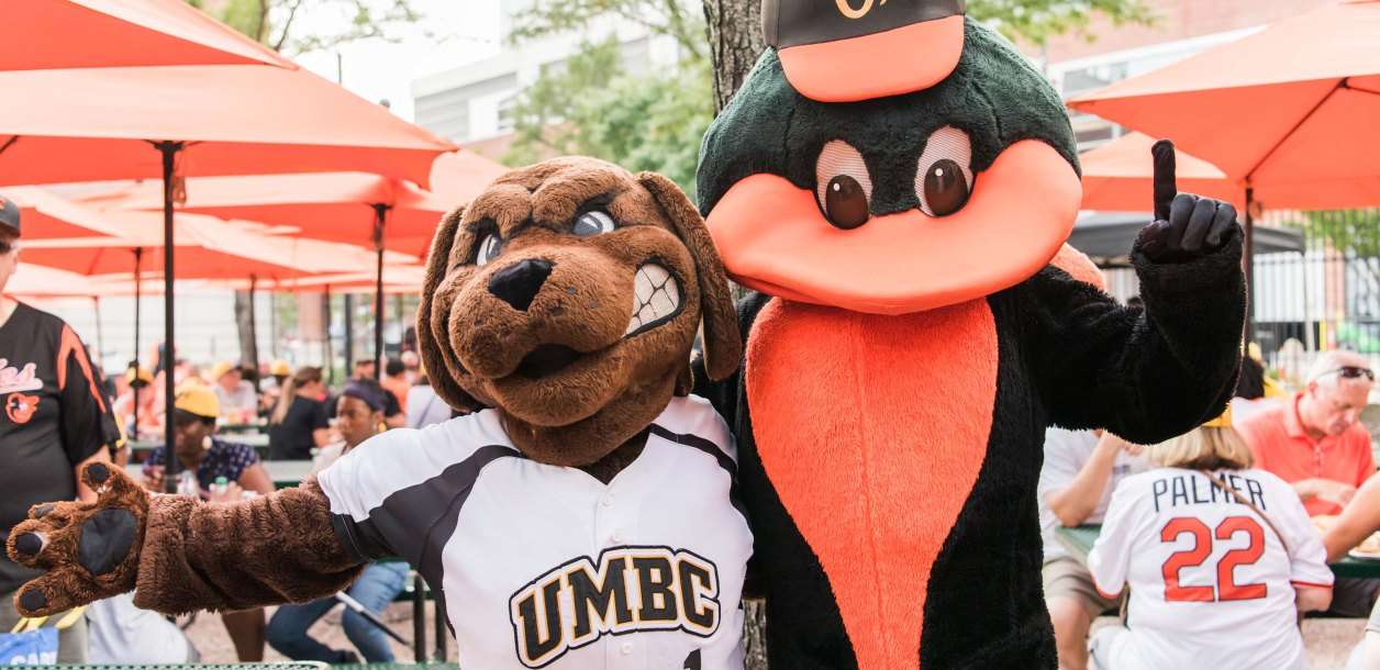 Orioles and UMBC Mascot posing together